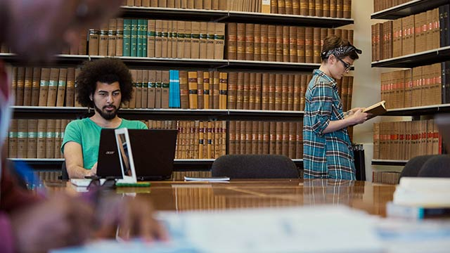Law students studying in the Law library