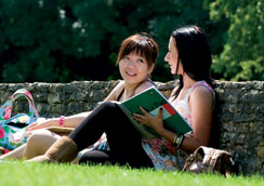 Female students sitting outside on Frenchay Campus