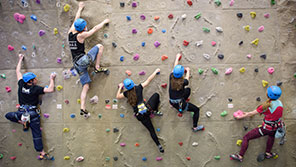 Climbers on the climbing wall at Centre for sport