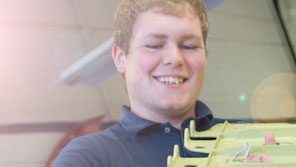 Engineering student holding a piece of equipment