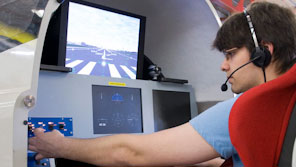 Aerospace engineering student using a flight simulator