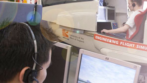 Two aerospace engineering students using flight simulators