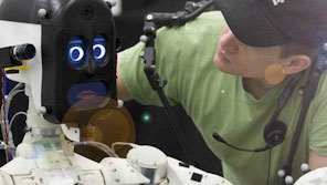 Student working on a robotic prototype in a lab