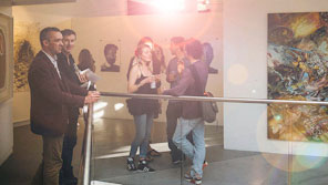 People attending an art exhibition in a gallery