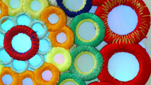 Close up of brightly coloured floral fabric decorations
