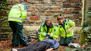 Student paramedics taking part in a simulated training exercise