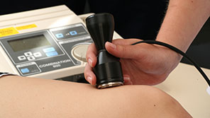 Physiotherapy student scanning a patient's knee