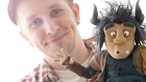 Animation student displaying a puppet he's created