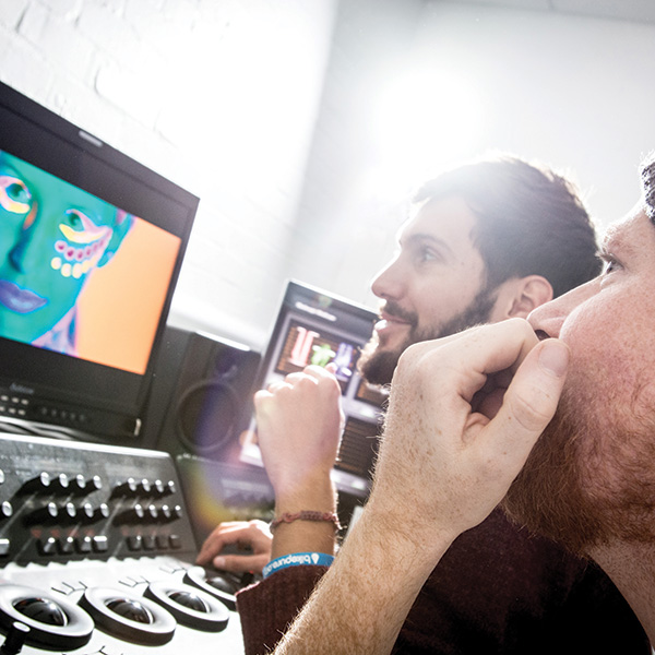 Two Animation degree students working on a computer