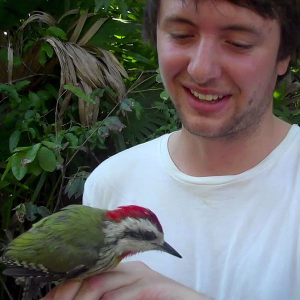 Environmental Science student handles bird on Cuban fieldtrip