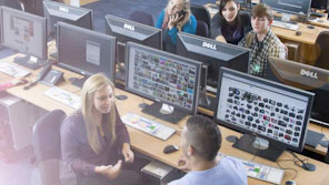 Students holding a conversation in a computer lab