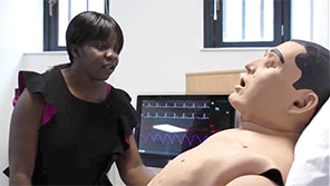 Nursing degree student Lusy with mannequin patient, Gloucester Campus
