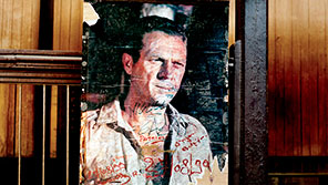 Signed Steve McQueen canvas propped against a banister.