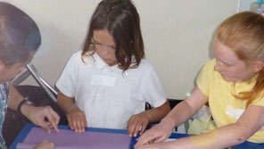 Two children working with a teacher