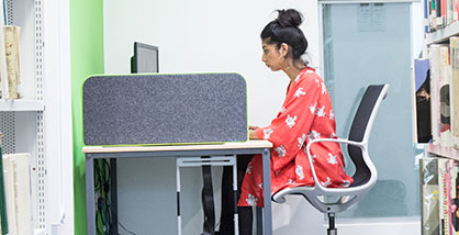 Student working at a computer in Bower Ashton Campus library