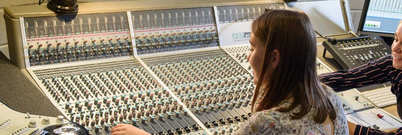 Mixing desk in a music studio