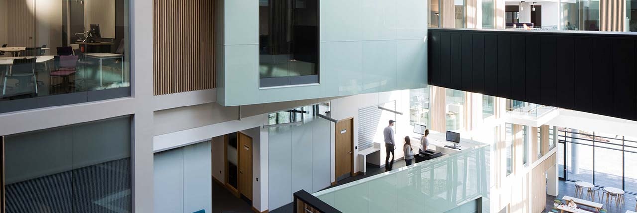Bristol Business School atrium showing glass panelled rooms