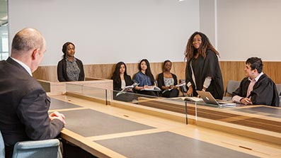 Students using a mock court room in Bristol Business School
