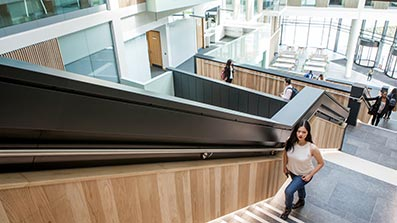 Looking down the main stairway into the atrium of Bristol Business School