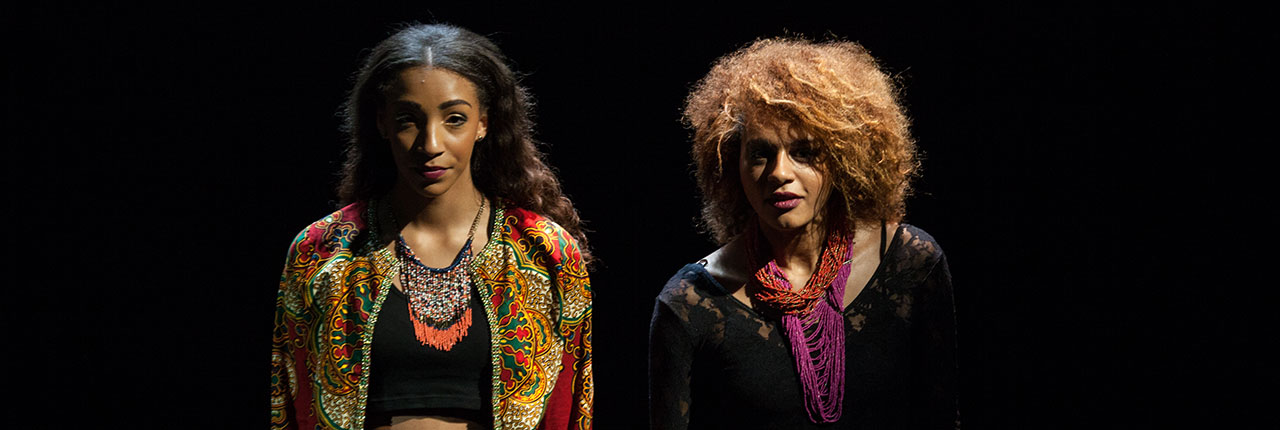 Two female models on stage at the Black History Month fashion show