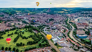 Aerial view of Bristol with some hot air balloons