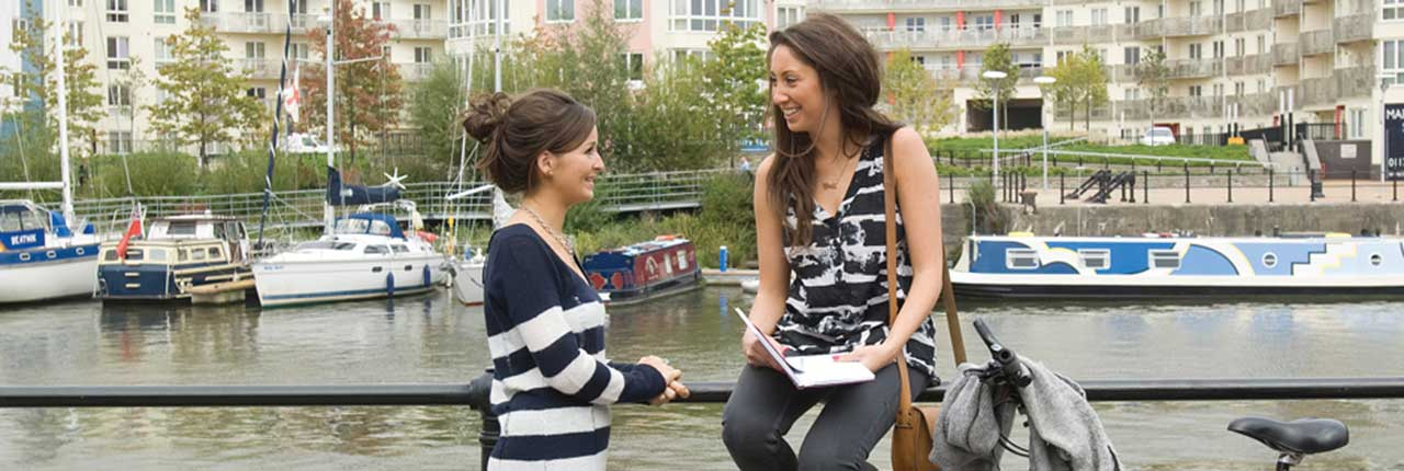 Two students stood on Bristol Harbourside