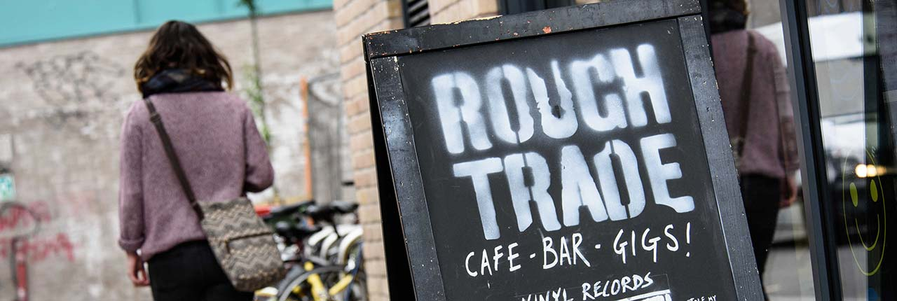 Rough Trade shop sign advertising gigs, records and cafe