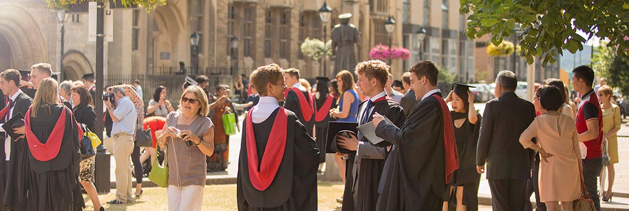 A panoramic view of graduants and guests at an Awards Ceremony at Bristol Cathedral