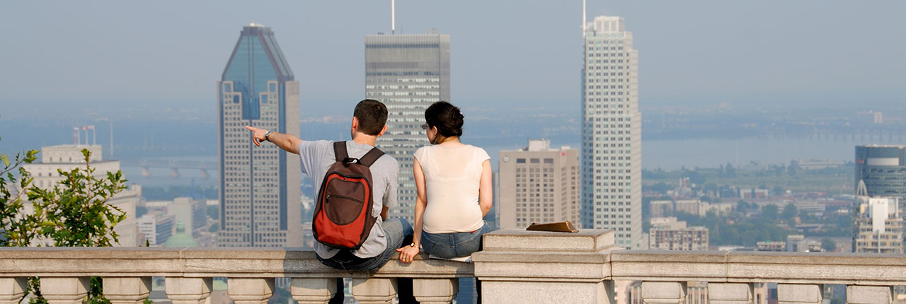 Two people watching the Montreal skyline