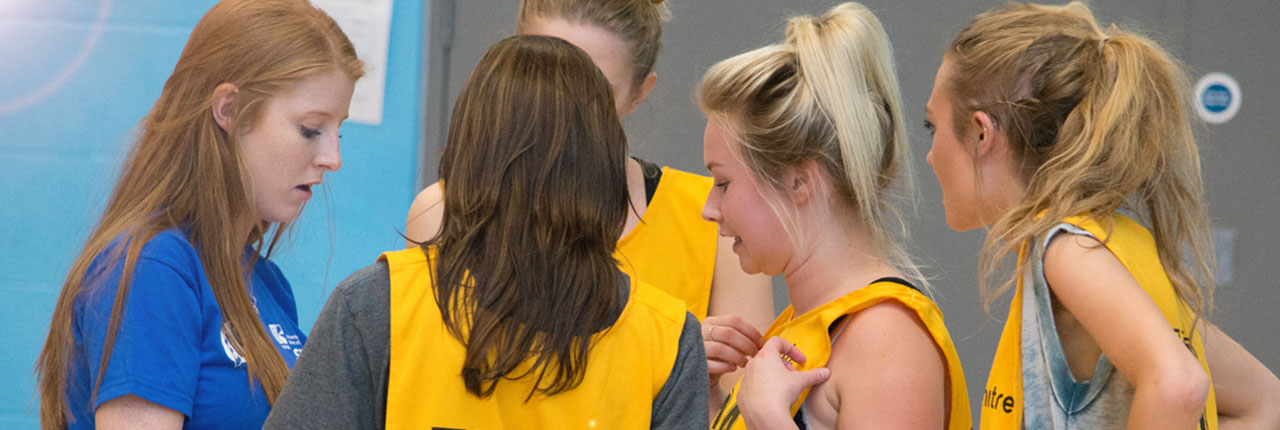 Netball Officer coaching players