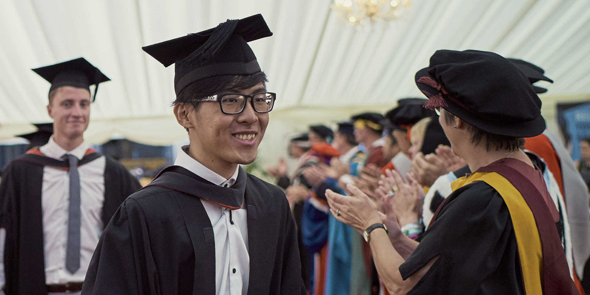 UWE Bristol students in a marquee on graduation day