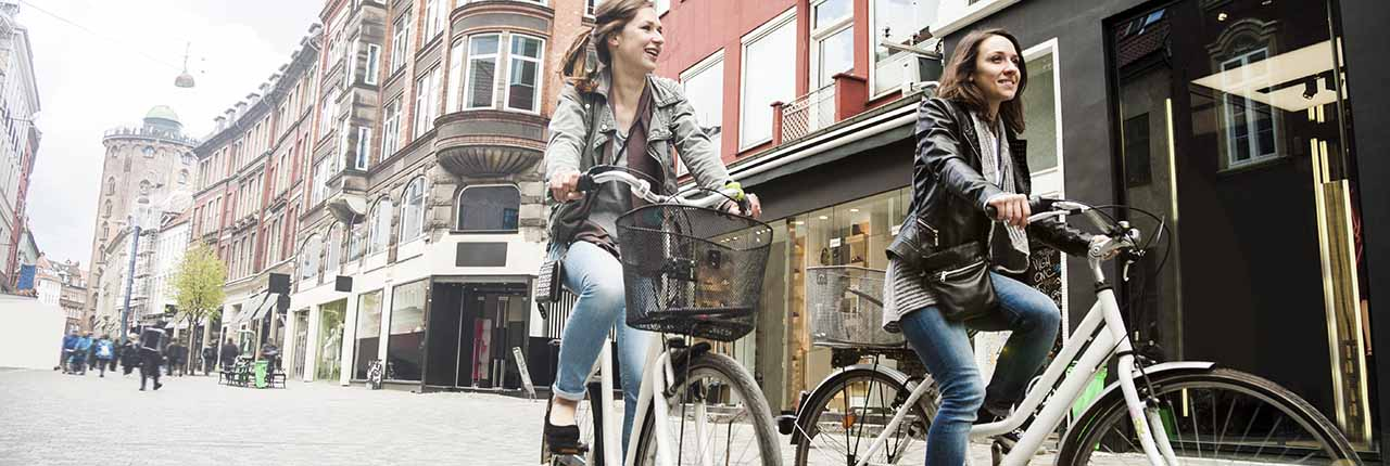 Two women cycling in Amsterdam