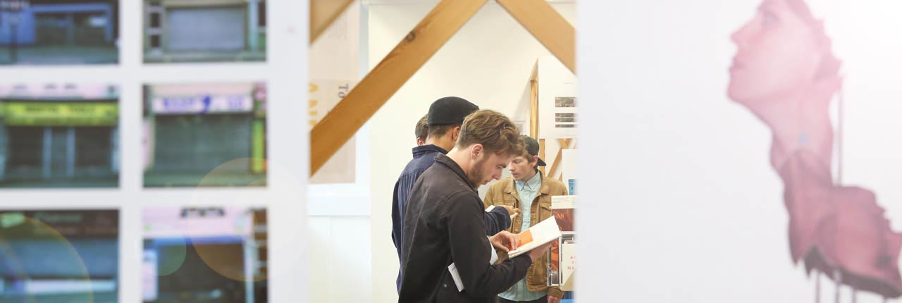 Design students browsing books