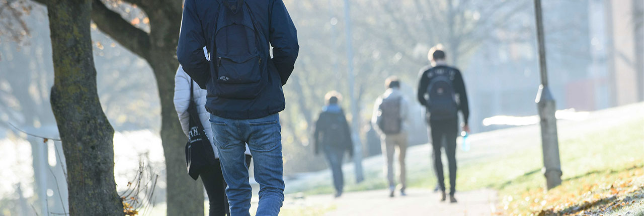 Students walking in the sunshine on a cold frosty day