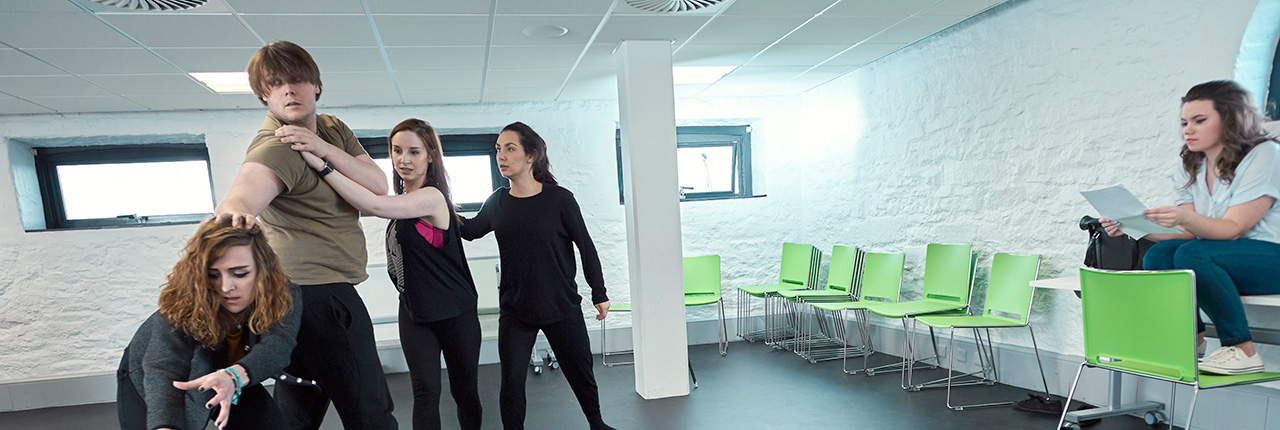 Drama students rehearsing in a studio