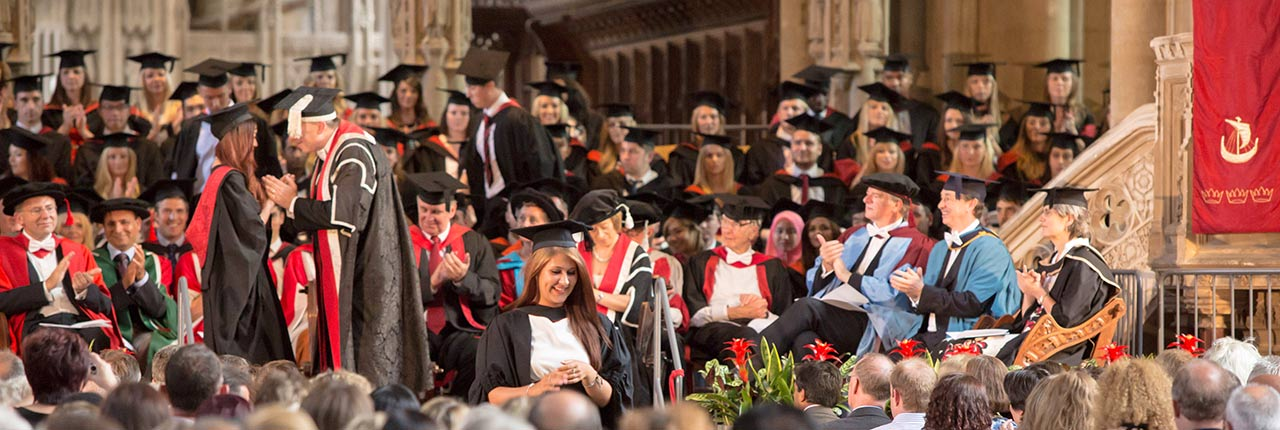 Graduand on stage during an Awards Ceremony