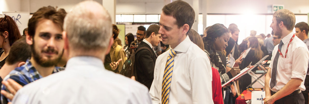 Employers talking to students at the Employers Fair