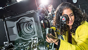 Female student working with television camera