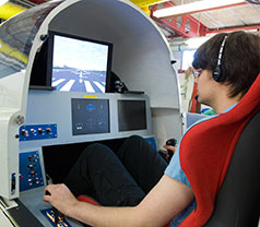 Student testing flight simulator