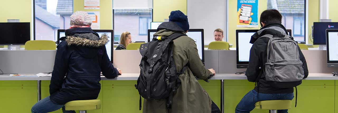 Students sat working at desks on Frenchay Campus