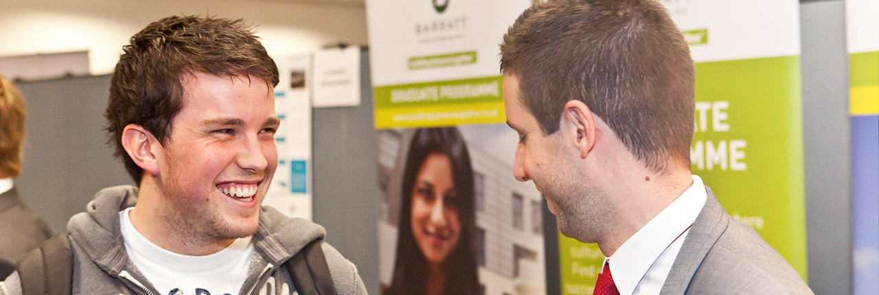 Student speaking with recruiter at careers fair