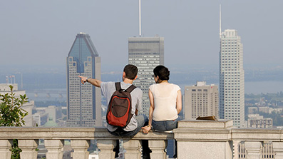 Two students watching the Montreal skyline