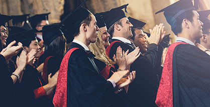 UWE Bristol graduates applauding during an Awards Ceremony