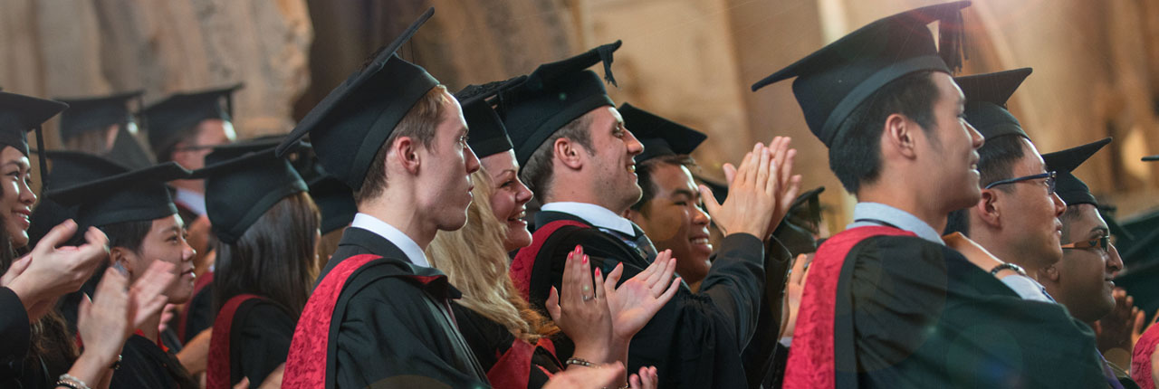 Graduands clapping at an awards cermony