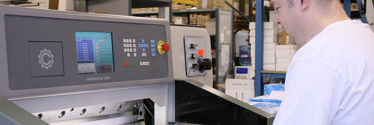 An electronic paper guillotine in operation