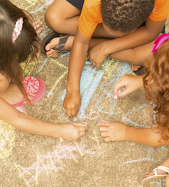 Children drawing with chalking in a playground