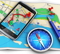Smartphone on a map with compass and pen