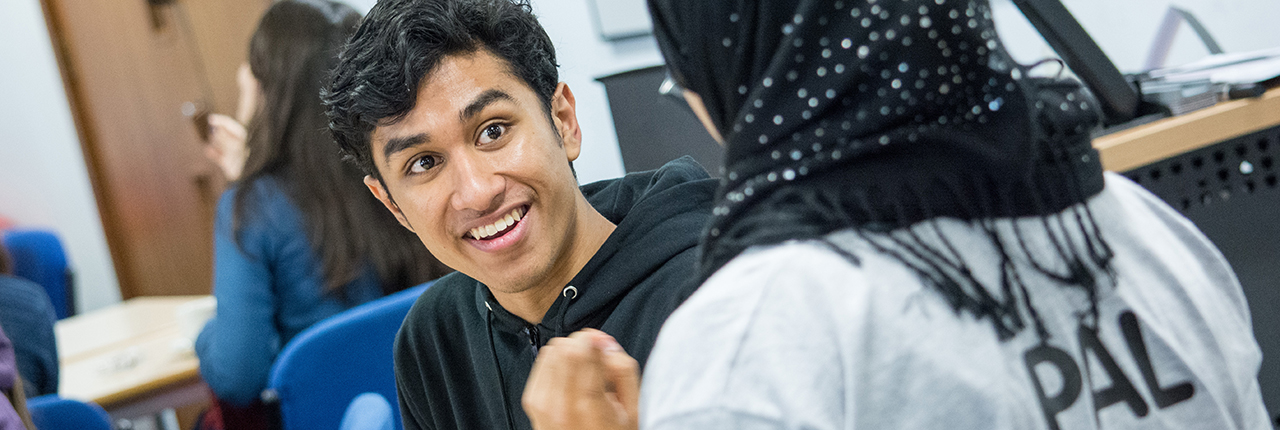 International student being offered support by Global Peer Assisted Learning leader