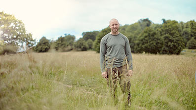 Student James standing in field