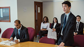 Students taking part in law court simulation